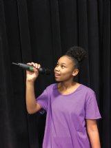 Columbus Middle School student Jada Spraggins, 13, sings during a theater practice. Spraggins scored