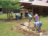 One of the Oktibbeha Master Gardeners' many previous projects at Catch-A-Dream headquarters has been to transform a drainage ditch into a winding stone-lined stream bed.