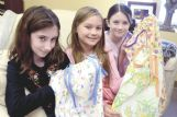 Lucy Whitwam, 11, Isadora Poros, 9, and Henrietta Krogh, 8, show off finished dresses June 16. Lucy and  Henrietta's parents are Ross Whitwam and Holly Krogh. Isadora is the daughter of John Poros and Leslie Stratyner.