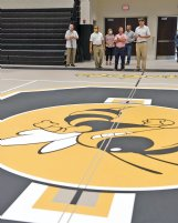 From left, John Brown, Superintendent Eddie Peasant, Principal Julie Kennedy, Wes Gordon, John Maulding and Sumner Davis look at the gymnasium during a tour of The Partnership School on Wednesday in Starkville. The SOCSD board took a tour of the nearly completed building on Wednesday morning.