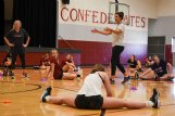"""Volleyball coach Samantha Brooks talks to the team while they stretch after a workout on Wednesday at Caledonia High School. """"We're ready to jump into it and get going,� Brooks said of starting summer workouts after some delays due to COVID-19."""