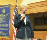 Mississippi University for Women Acting President Nora Miller speaks at Columbus Rotary Club Tuesday afternoon at Lion Hills Center. Miller said adding new sports this year kept the university from having to cut its budget.