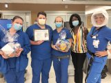 Baptist Memorial Hospital-Golden Triangle Performance Improvement Coordinator Jackie Norris, RN, second from right, recently presented candy baskets and a AHA certificate to the Emergency Room staff in appreciation for their efforts in meeting specific quality measures to achieve the American Heart Association 2020 Stroke Bronze Award. Shown accepting for both the day and night shifts are from left, Head Nurse Jessica Weseli, Jordan Sudduth, RN, Brandi Durham, RN, Norris and Megan Helms, RN. The ER staff had to administer tissue plasminogen activator, or tPA to qualifying stroke patients within 60 minutes of admission over three consecutive months. Other stroke quality measures involving the transfer of stroke patients and the treatment of stroke patients admitted as inpatients also had to be met to qualify for the award. All data was for 2019, according to Norris.