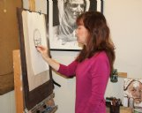Cindy Buob works on a charcoal drawing Friday morning at her student in downtown Columbus.