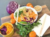 A colorful peanut power bowl brings roasted peanuts together with farro or quinoa, mandarin oranges, carrots, avocado and zucchini or butternut squash.