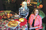 Patricia Corbett, left, and Janice Christian are pictured with Corbett's fried apple pies and apple brownies, and Christian's habanero apple jellies.