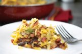 Garlic, ham, bell pepper and onion wake up these cheesy hash browns.
