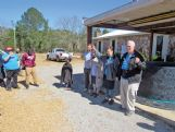Pastor Steve Blaylock, right, his wife, Pat, daughter-in-law Lanita and son, Craig, address church members in an impromptu church service next to the ruins of the church which was destroyed by Saturday's tornado.