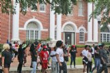 Protesters at a demonstration against the Confederate monument outside the Lowndes County Courthouse yell at law enforcement officers and an individual who approached the crowd while appearing to be armed.