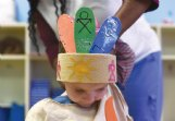 Marlee Cate Hudson, daughter of Robby and Anna Hudson, wears a colorful Native American-inspired headdress for dress rehearsal Wednesday.