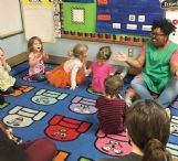 Early Childhood Educator Chandra Steele reads to students at Mississippi University for Women's Child and Parent Development Center, one of several childcare organizations for children under 5 represented in the Lowndes County Excel by 5 candidate coalition.