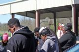 Outside the Townsend Community Center, East Columbus residents prayed for those affected by Saturday night's tornado. Eleven people were injured and one was confirmed dead.