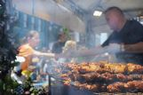 Food vendors were busy during the Market Street Festival in Columbus Saturday. Chicken kabobs lay smoking on a rack for lunch time.