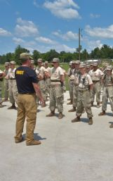 Parker Casano receives instructions from an Extreme Military Challenge instructor at Camp Liberty.