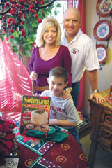 Liz Robinson and her husband, Maj. Brett Robinson, first began organizing an annual December meal outreach in 2007. Last year, volunteers delivered 1,200 meals into Columbus neighborhoods. This year's goal is 5,000. The Robinson's son, 6-year-old Grant, will help deliver with his parents Dec. 17. Liz's cookbooks help with ideas for the annual meal.