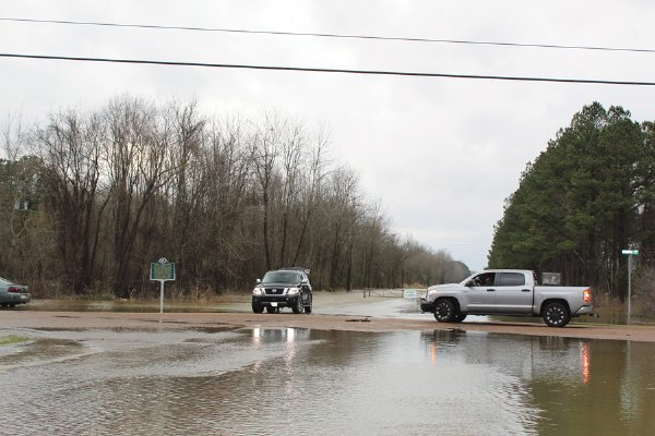 A closed road sign has drivers turning around at the intersection of Wilkins Wise Road and Officers Lake Road Wednesday evening. Rising flood waters make it impossible to get all the way to the Columbus Lock and Dam. / Photo by: Isabelle Altman/Dispatch Staff