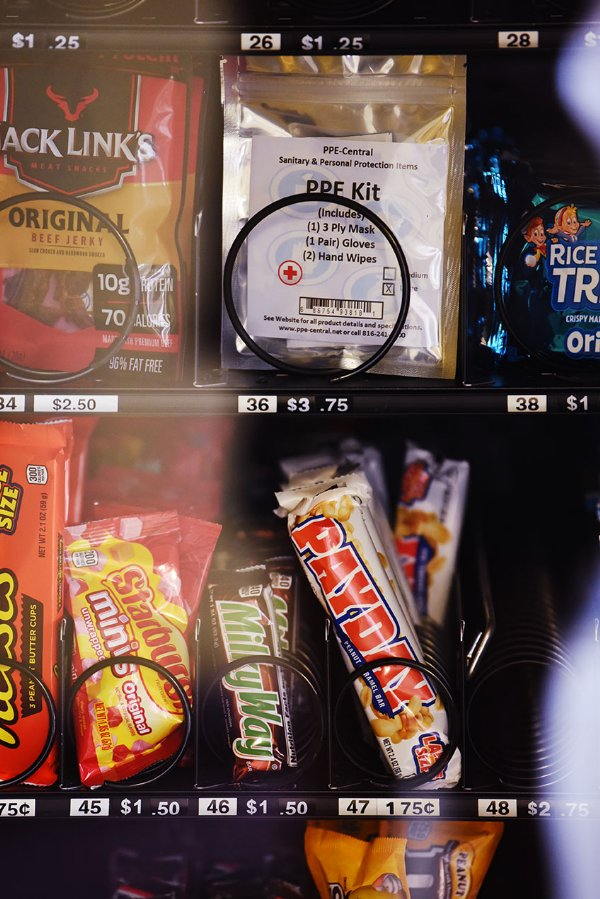 A PPE kit sits among candy and snacks in a vending machine on Wednesday at Herbert Hall on the MSU campus in Starkville. Students will begin moving to campus on Friday, according to Dante Hill, Associate Director of Resident Education. / Photo by: Claire Hassler/Dispatch Staff