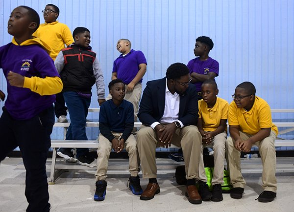 "Ward 4 City Councilman Pierre Beard visits with young boys Nov. 1 at the Boys & Girls Clubs of Columbus. ""It took a village to raise me. I'm not where I want to be yet, but I'm so far from where I could be. I just want to give the kids a chance to expand their horizons and let them be around regular people who have important, amazing jobs and tasks, and let them know they can be whatever they want to be,"" Beard said. / Photo by: Jennifer Mosbrucker/Dispatch Staff"