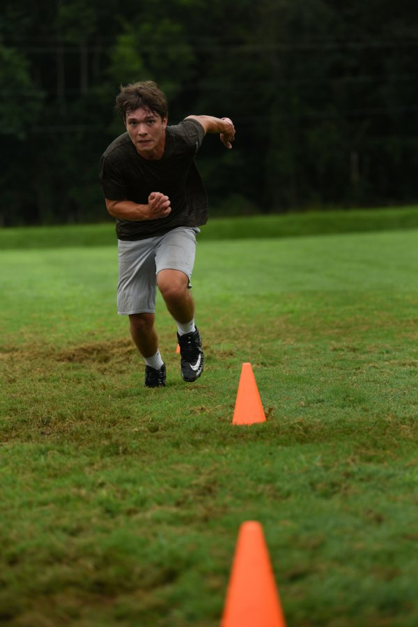 Junior Drake Lowery catches his breath before starting sprints during a football workout on July 9 at Pickens Academy in Carrollton. / Photo by: Claire Hassler/Dispatch Staff