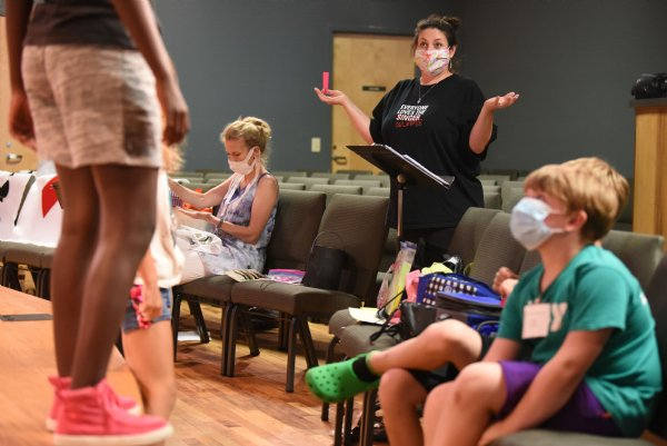 Celsie Staggers demonstrates a pose to her campers during the Atmos Energy Summer Arts Academy on Thursday at the Columbus Arts Council. Campers explored theater, music and dance all week. / Photo by: Claire Hassler/Dispatch Staff