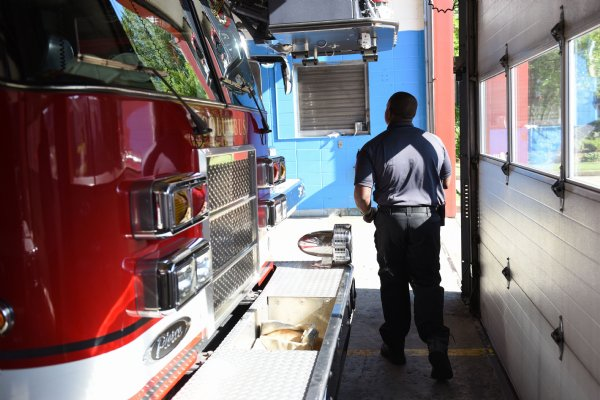 Justin Martin walks through Fire Station 1 on Thursday in Columbus. Martin said he always knew he wanted to be a firefighter. He's also a fitness instructor at Core Fitness in Columbus. / Photo by: Claire Hassler/Dispatch Staff
