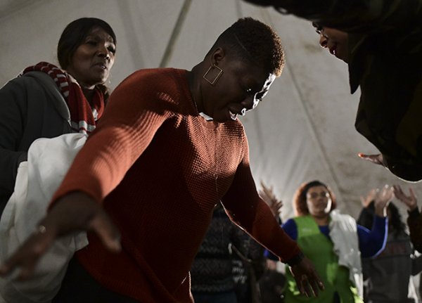 """Alexis McMullen is overcome by the Holy Spirit as she stands near the front of the stage. """"When I went up there I knew that the Lord had something for me and he used him to tell me, and everything he that he told me I already knew because he spoke it to me as a child. I know the calling God has on my life. I am a minister but there's more levels that God wants to take me. In doing so I need to Surender more to him. I need to give up everything, my desires, for the glory of God."""" / Photo by: Jennifer Mosbrucker/Dispatch Staff"""