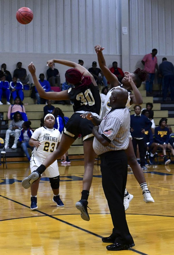 New Hope's Juquala Sherrod, left, and West Lowndes' Nenah Young tip off for the ball at the start of the varsity game Nov. 30 at West Lowndes High School. The ball went to New Hope. / Photo by: Jennifer Mosbrucker/Dispatch Staff