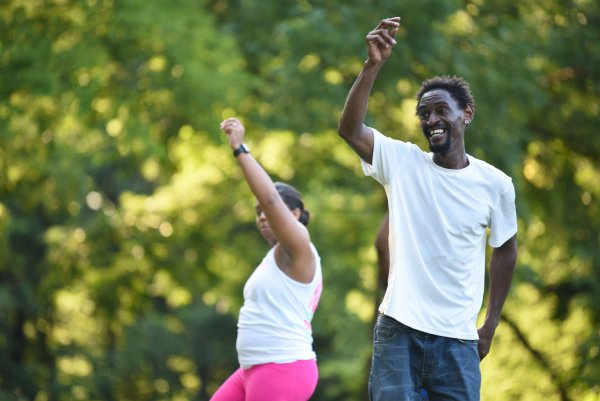Darrett Harris puts his hand in the air during a Zumba class on Tuesday evening at the River Walk Soccer Complex in Columbus. The class lasted about an hour. / Photo by: Claire Hassler/Dispatch Staff
