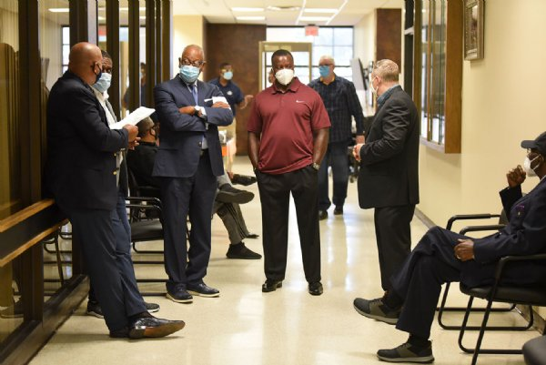 Community faith leaders stand in the hallway of the Lowndes County Courthouse on Monday during the supervisors meeting in Columbus. Due to COVID-19, scheduled speakers on the agenda had to wait outside the meeting room. / Photo by: Claire Hassler/Dispatch Staff