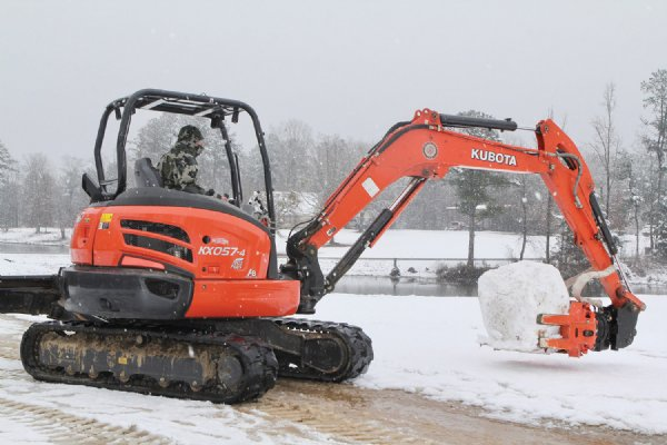 Tim O'Bryant of New Hope uses a mini-excavator to help build a snowman. / Photo by: Courtesy photo