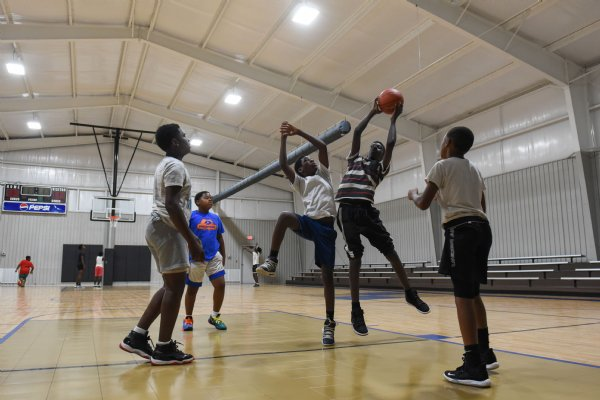 A group of friends plays basketball on Thursday at the Crawford Community Center. The boys came from Crawford, Artesia and Starkville to play on the new court. / Photo by: Claire Hassler/Dispatch Staff
