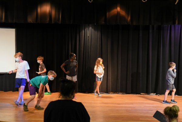 From left, Hutch Clemons, 11, Charlie Clemons, 7, Jack Clemons, 9, Leah Jeremiah, 12, Annabelle Brislin, 8, and Kanat Sarp, 7, do improv while their theater teacher, Celsie Staggers, watches during the Atmos Energy Summer Arts Academy on Thursday at the Columbus Arts Council. / Photo by: Claire Hassler/Dispatch Staff
